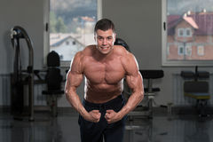Bodybuilder Performing Most Muscular Pose Royalty Free Stock Photo