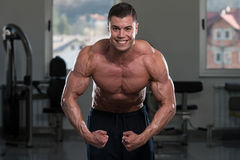 Bodybuilder Performing Most Muscular Pose Stock Photos