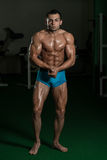 Bodybuilder Performing Most Muscular Poses Stock Images