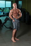 Bodybuilder Performing Side Chest Pose Royalty Free Stock Photography