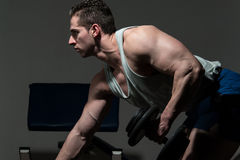 Bodybuilder Performing Triceps With A Dumbbell Stock Photography
