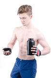 Bodybuilder and pills. After training. Royalty Free Stock Photo