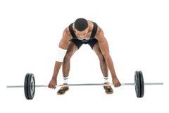 Bodybuilder podnosi ciężkich barbell ciężary zdjęcie stock