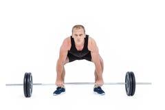 Bodybuilder podnosi ciężkich barbell ciężary fotografia stock