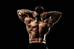 Bodybuilder posing. Stock Image