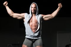 Bodybuilder Posing Biceps After Exercises royalty free stock photos