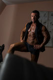 Bodybuilder posing in black shirt without sleeves Stock Image