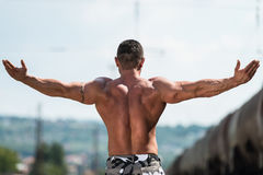 BodyBuilder Posing Double Biceps Royalty Free Stock Image