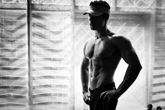 Bodybuilder posing in the gym Stock Photo