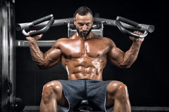Bodybuilder in a posing gym. Doing different exercises stock photos