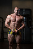 Bodybuilder Posing In The Gym Royalty Free Stock Photography