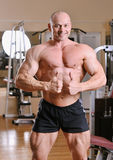 Bodybuilder posing at gym Stock Photo