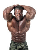 Bodybuilder posing. Handsome power athletic guy male. Fitness muscular body.  Isolated on white background Royalty Free Stock Photography