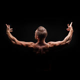 Bodybuilder Posing. Muscles the shoulders. Royalty Free Stock Image