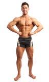 Bodybuilder posing over white Royalty Free Stock Photos