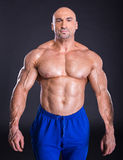 Bodybuilder. Is posing, showing his muscles. Force, relief, muscle, courage, virility, , bodybuilding. The concept of a healthy lifestyle Royalty Free Stock Photo