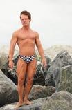 Bodybuilder posing in speedos Royalty Free Stock Photo
