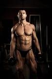 Bodybuilder posing Royalty Free Stock Photos
