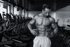 Bodybuilder Posing With Supplements For Copy Space Royalty Free Stock Image