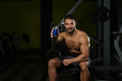 Bodybuilder Posing With Supplements For Copy Space Royalty Free Stock Photography