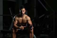 Bodybuilder Posing With Supplements For Copy Space Stock Image