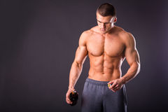 Bodybuilder pours beer Royalty Free Stock Photo