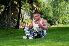 Bodybuilder Practicing Yoga Royalty Free Stock Photo