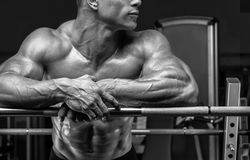 Bodybuilder prepare to do exercises with barbell Royalty Free Stock Image