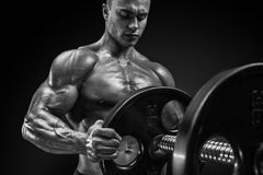 Bodybuilder prepare to do exercises with barbell Royalty Free Stock Images