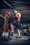 Bodybuilder preparing for deadlift of barbell Royalty Free Stock Photo