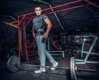 Bodybuilder preparing for deadlift of barbell Royalty Free Stock Photography