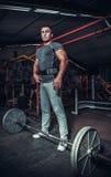 Bodybuilder preparing for deadlift of barbell Stock Photos