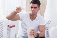 Bodybuilder preparing protein shake Royalty Free Stock Image