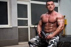Bodybuilder with Protein Shake stock photos