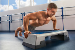 Bodybuilder pushing up Royalty Free Stock Image