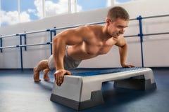 Bodybuilder pushing up Royalty Free Stock Image
