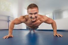 Bodybuilder pushing up Stock Photography