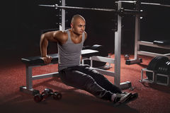 Bodybuilder pushing up Stock Photos