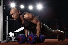Bodybuilder pushing up Stock Image
