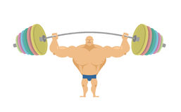 Bodybuilder raises sports barbell with colored discs.  Royalty Free Stock Photos