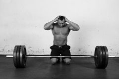 Bodybuilder is ready for action. An athlete is preparing to lift a heavy dumbbell Stock Photography