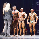 Bodybuilder receives his medal from the official Stock Photo