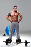 Bodybuilder relaxed, posing Royalty Free Stock Photography