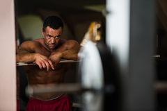 Bodybuilder resting after doing heavy weight exercise Stock Image