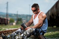 Bodybuilder Resting And Drinking Protein Shake Stock Photo