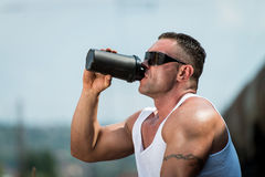 Bodybuilder Resting And Drinking Protein Shake Royalty Free Stock Images