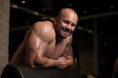 Bodybuilder Resting In The Gym Royalty Free Stock Photos