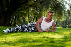 Bodybuilder Resting And Holding Water Bottle Stock Photography