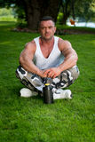 Bodybuilder Resting In Nature Royalty Free Stock Photography