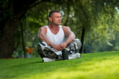 Bodybuilder Resting In Nature Stock Photos